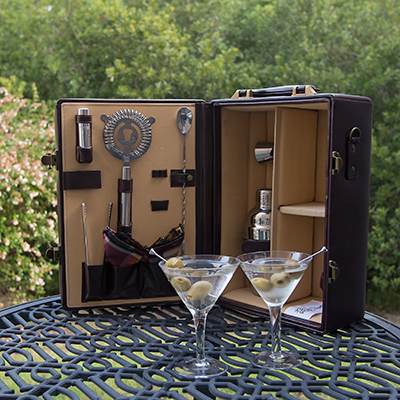 PICNIC TIME<sup>&reg;</sup> Manhattan Portable Cocktail Case - Everything you need for a cocktail party on the go!  Leatherette case with velveteen lining holds 2 martini glasses, 2 cloth napkins, and several stainless steel bar tools including a double-sided jigger, ice tongs, a strainer and olive picks. Features heavy-duty suitcase-style case with handle and detachable shoulder strap.