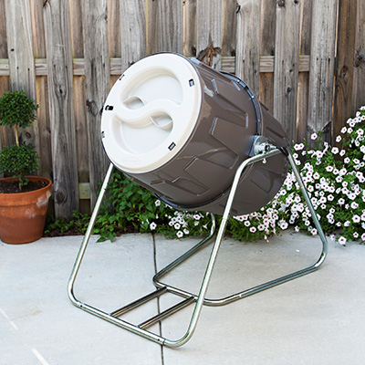 SUNCAST<sup>&reg;</sup> Tumbling Composter - Go green and nourish your garden and flower bed with this standing, tumbling composter. This composter has 6.5 cubic feet of capacity, features dual lids for easy fill and emptying, spring-loaded lock that maintains its position when loading and unloading and sits on a sturdy galvanized steel frame.  Assembled size is 30.5