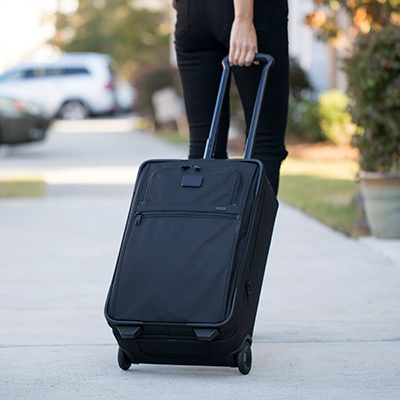 TUMI <sup>&reg;</sup> Alpha 2 International Expandable 2-Wheel Carry-On - Simple and streamlined, this 2-wheeled bag is big enough to pack the basics at 22