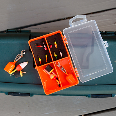 CELSIUS<sup>®</sup> Ice Panfish Kit - Find those winter panfish with this ice fishing kit.  This reusable tackle box includes jigs, hooks, depth finders, shots and more.